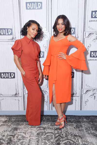 Regina Hall stayed on trend in an orange Lavish Alice cold-shoulder dress with bell sleeves during her visit to the Build Series.