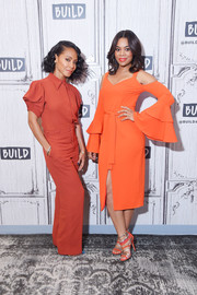 Regina Hall complemented her dress with a pair of orange and silver multi-strap sandals by Jimmy Choo.