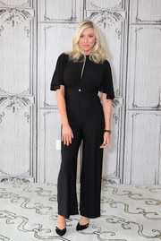 Stassi Schroeder wore a stylish black jumpsuit with flutter sleeves when she attended Build Presents 'Straight Up with Stassi.'