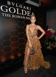 Jasmine Sanders teamed her frock with red ankle-strap sandals.