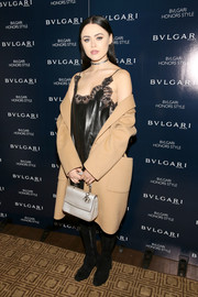 Kristina Bazan arrived for the Bulgari Honors Style event wearing a bulky beige coat over a black leather slip dress.