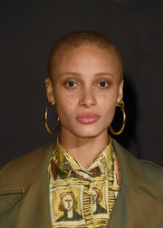 Adwoa Aboah attended the Burberry show wearing her hair in a breezy buzzcut.