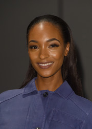 Jourdan Dunn pulled her hair away from her face in a sleek half-up style for the Burberry fashion show.