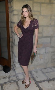 Lake paired her purple lace look with leather, slingback sandals.