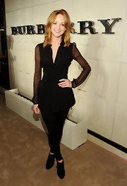 Jayma Mays shirked 'Glee' character Emma Pillsbury's signature girly aesthetic at the Burberry Body launch in a gothic black lace-up top with sheer sleeves.