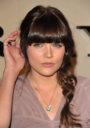 Emma Greenwell wore her super shiny tresses in a casual side braid at the Burberry Body launch.