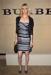 Lydia Hearst topped off her chic striped cocktail dress with suede blue pumps.