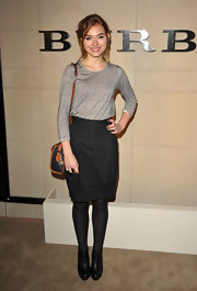 Imogen Poots kept her style unfussy with a no nonsense black leather bag with tan trim.