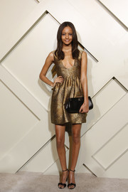 Malaika Firth styled her outfit with a classic black frame clutch.