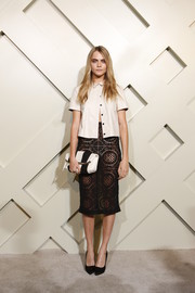 Cara Delevingne finished off her ensemble with a black-and-white Burberry clutch.