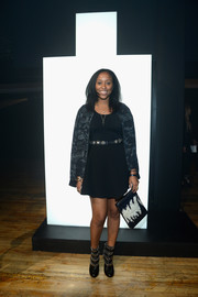 Shiona Turini kept the edgy vibe going with a pair of studded black boots.