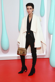Ruby Rose contrasted her white cape with black skinny pants.