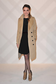 Solweig Rediger was a classic beauty in a long camel coat with satin lapels.