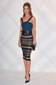 Rosie Huntington-Whiteley topped off her Burberry dress with a wide woven belt to accentuate her tiny waist.