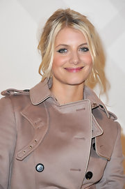 Melanie Laurent wore her hair in a simple, casual updo at the Burberry boutique opening in Paris.