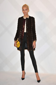 Anja Rubik showed off her svelte figure in skinny leggings topped off with classic black stilettos.