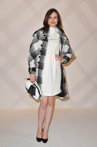 Sophie Michelle Ellis-Bextor looked ultra-chic in a black and white plaid wool coat, which she layered over a white babydoll dress.