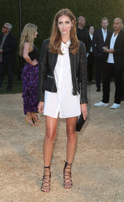 Chiara Ferragni was edgy-sexy in a black Burberry leather jacket layered over a short white shirtdress during the London in Los Angeles show.