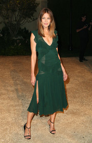 Michelle Monaghan exuded ultra-feminine appeal at the London in Los Angeles show in an emerald-green Burberry frock with a thigh-baring slit and ruffle embellishments.