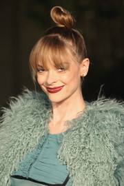 Jaime King sported a playful top knot and eye-grazing bangs during the Burberry London in Los Angeles show.
