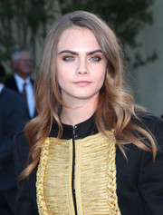 Cara Delevingne attended the Burberry London in Los Angeles show sporting soft, side-parted waves.
