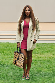 Serena sported a classic trench over her fuchsia ruched dress.