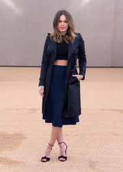 Atlanta de Cadenet Taylor teamed a navy trenchcoat with a crop-top and an A-line skirt for the Burberry fashion show.