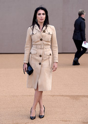Nadine Labaki stepped out for the Burberry fashion show wearing a beige trenchcoat from the brand.