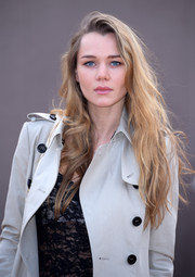 Immy Waterhouse attended the Burberry fashion show wearing a messy side-parted hairstyle.