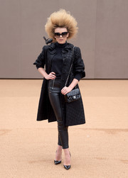 For a touch of edge, Tallia Storm wore black leather skinnies with her elegant coat.