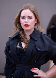 Tanya Burr attended the Burberry fashion show looking oh-so-charming with her loose fishtail braid.