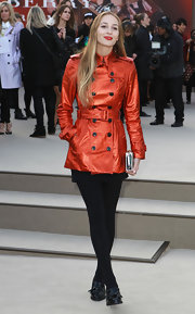 Harley Viera-Newton showed off her fiery red lips and matching trench coat at Burberry Prorsum's runway show.