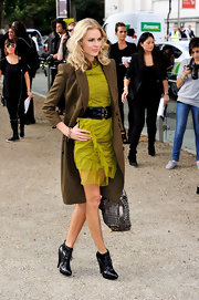 Donna looked sensational in her lime green ruffled dress. She completed her look with lace up ankle boots.