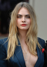 Cara Delevingne opted for a disheveled-chic center-parted 'do when she attended the Burberry fashion show.