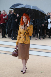 Paloma Faith looked quintessentially Burberry in a tan leather trenchcoat during the brand's fashion show.
