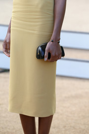 Naomie Harris was all about simplicity at the Burberry Prorsum fashion show with this tiny black leather clutch and sheath dress combo.