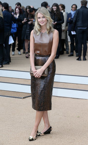 Donna Air finished off her ensemble in conservative style with a pair of embellished wedge pumps.