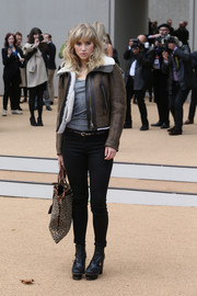 Suki Waterhouse was tough-chic in a bomber jacket and skinny jeans at the Burberry Prorsum fashion show.