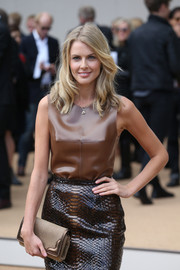 Donna Air rocked an ultra-chic studded clutch, leather top, and python skirt combo at the Burberry Prorsum fashion show.