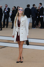 Harley Viera-Newton was spotted at the Burberry Prorsum fashion show wearing a nude trenchcoat over a mini dress.