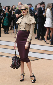 Leigh Lezark looked very dressy in a beige cropped jacket and a plum pencil skirt at the Burberry Prorsum fashion show.