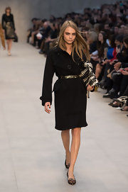 Cara Delevingne strutted down the runway with Burberry Prorsum's trenchcoat on.