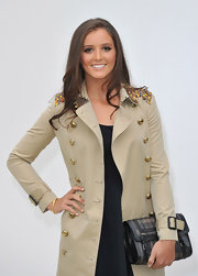 Wearing a military coat and carrying a textured leather clutch, Laura Robson was supremely stylish at the Burberry fashion show.