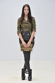 Kaya Scodelario pulled together her flawlessly styled look with a buckled clutch.