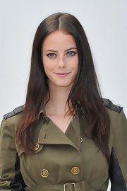 Kaya Scodelario looked gorgeous at the Burberry fashion show even with a minimally styled center-parted 'do.