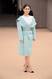 Miroslava Duma looked oh-so-elegant in a pastel-blue wool coat during the Burberry fashion show.