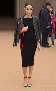 Ashley Madekwe oozed classic elegance in a figure-hugging LBD during the Burberry fashion show. The Brit leather jacket added extra oomph.
