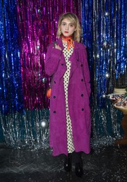 Natalia Dyer hit the Burberry x Cara Delevingne Christmas party wearing a magenta suede trenchcoat.