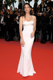 Julia Restoin-Roitfeld cut a shapely silhouette in this form-fitting cream gown by Narciso Rodriguez at the Cannes Film Festival screening of 'Burning.'