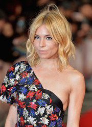 Sienna Miller looked darling with her golden waves at the European premiere of 'Burnt.'